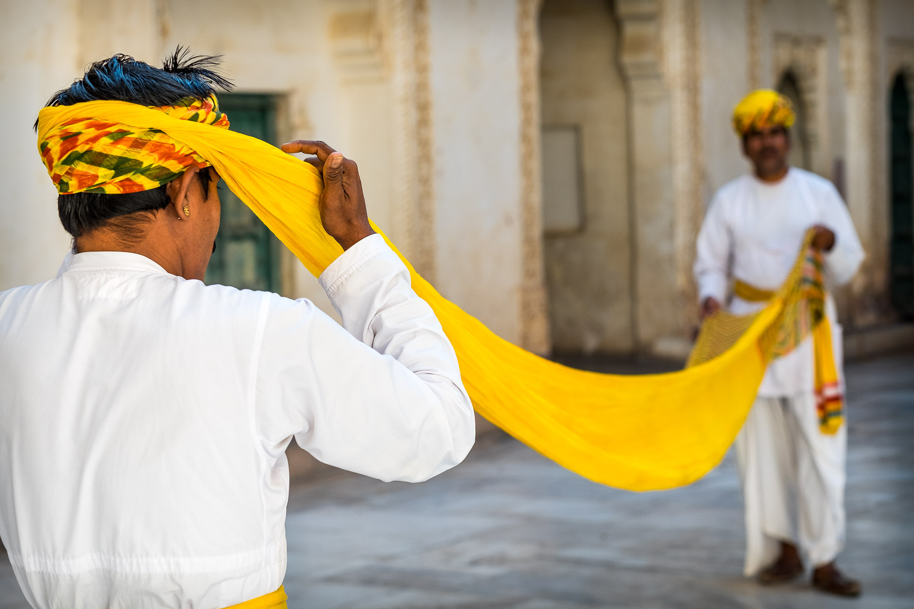 T Fixing his turban, Rajasthan, India