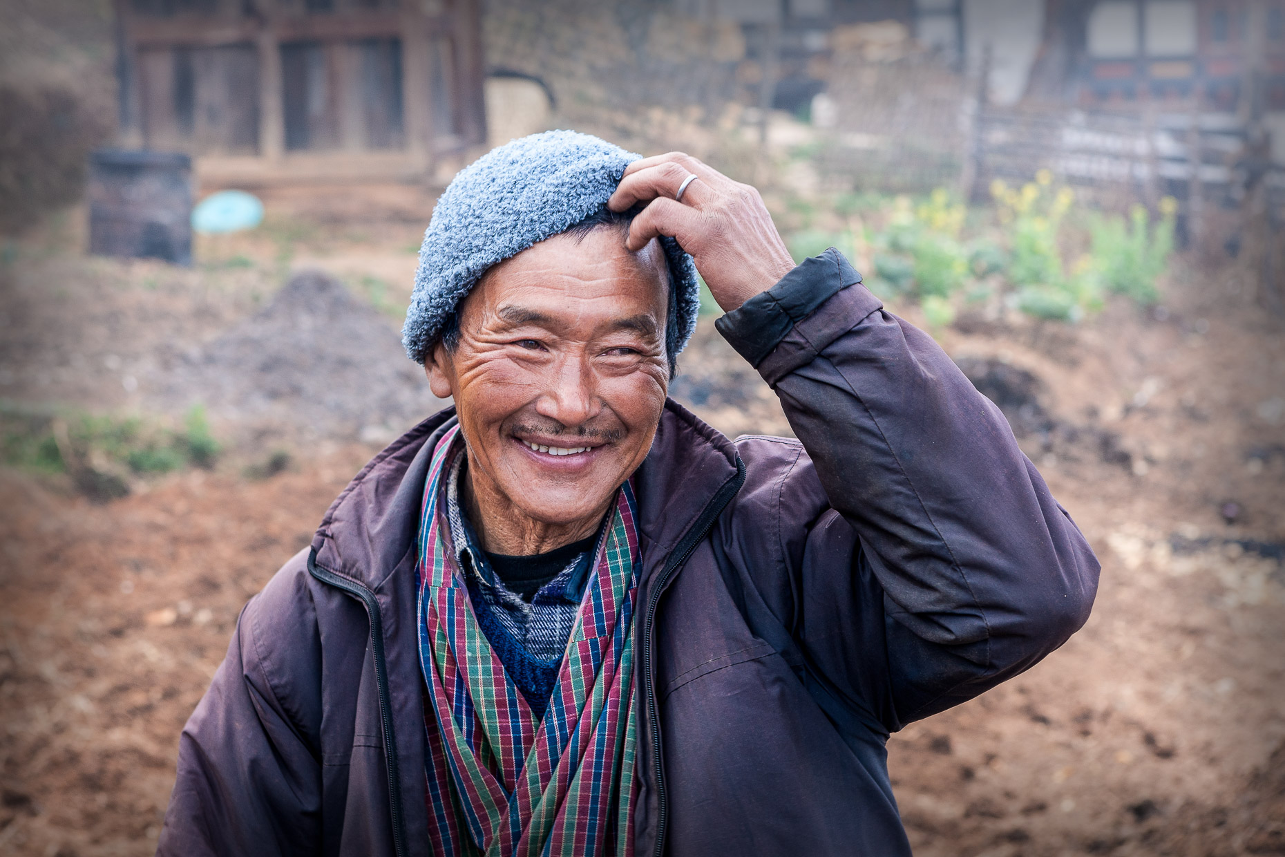B Happy farmer, Sakteng, Bhutan