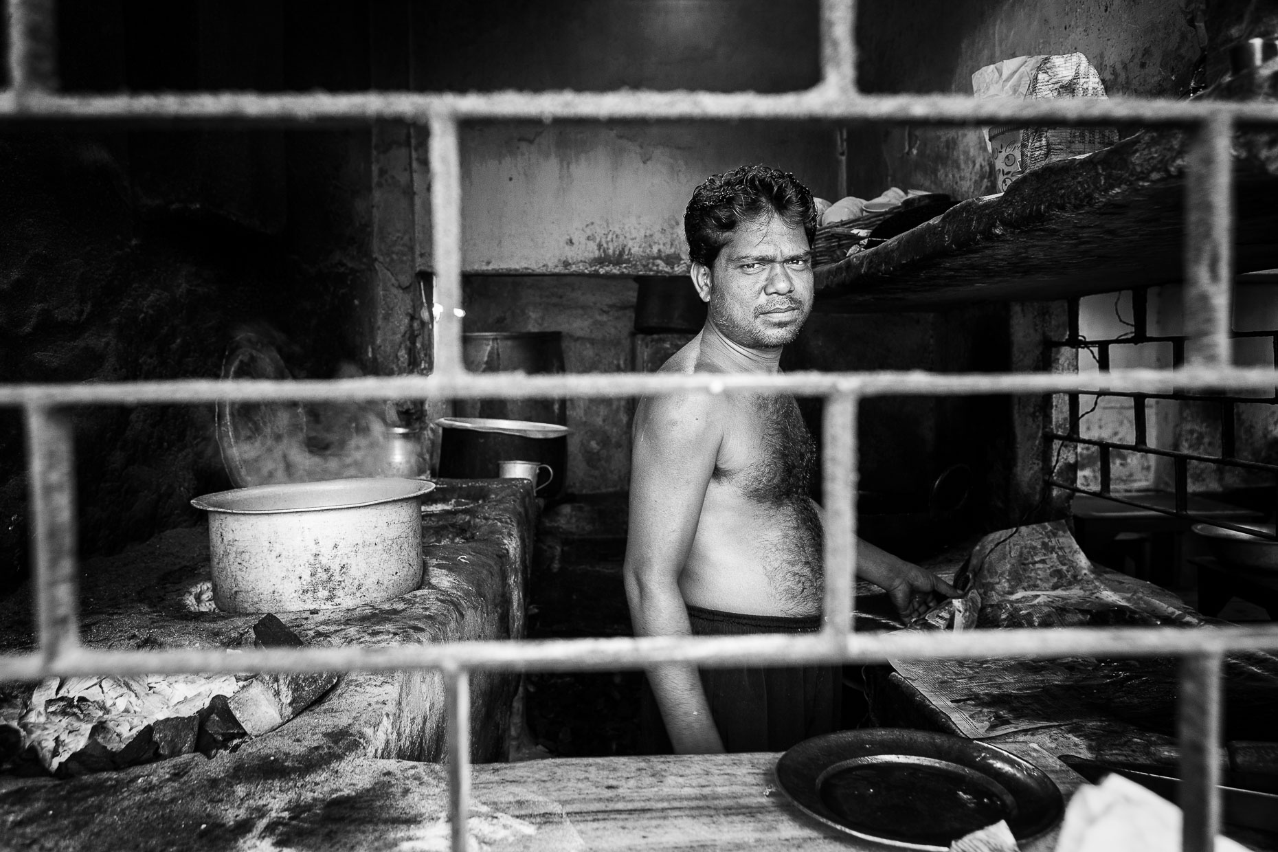 T Working in the kitchen, Kolkata, India